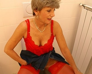 Granny is licking a male ass on a toilet